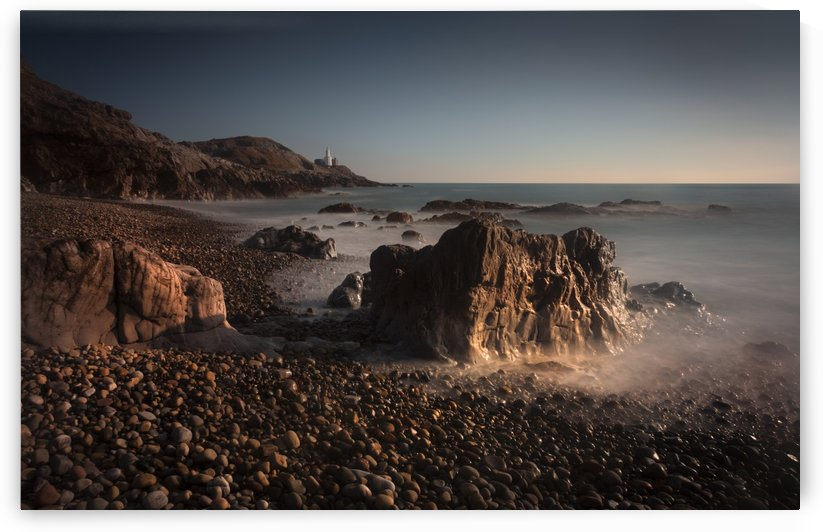 The rocky foreshore at Bracelet Bay by Leighton Collins