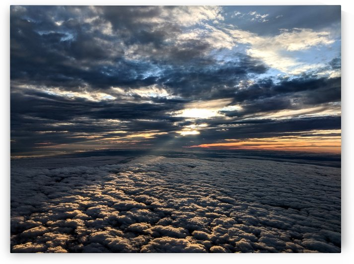 Light peering down upon the clouds by Michael Geyer