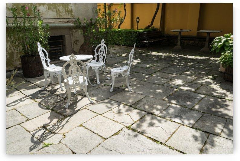Sun Dappled Invitation - Ubercharming Courtyard with Elegant Cast Iron Furniture by GeorgiaM