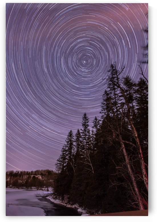 Star trails over the river by RezieMart