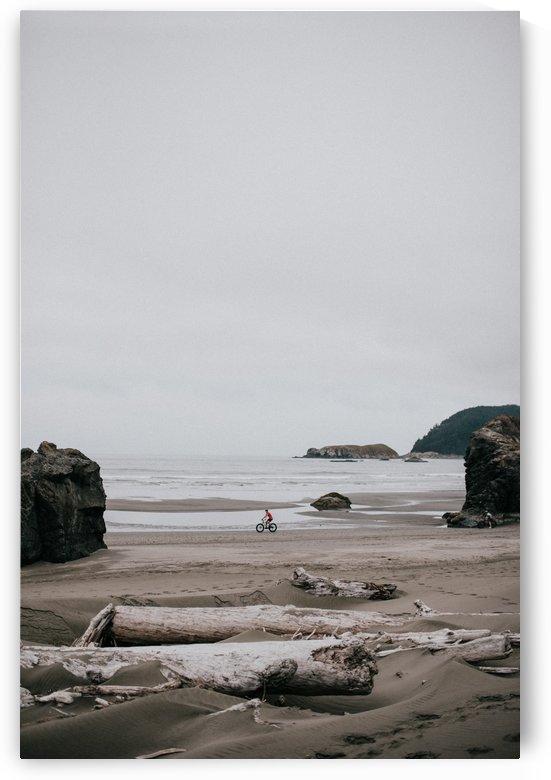 Cyclist on the beach by StephanieAllard