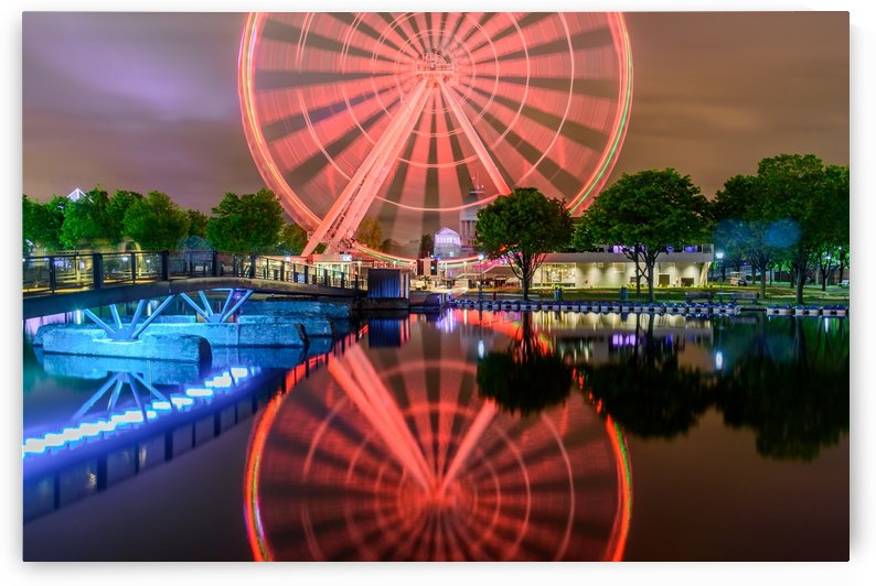 Reflection of illuminated La Grande Roue de Montreal by RezieMart