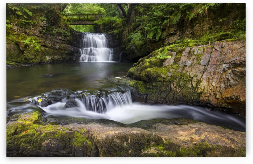 The waterfall behind Dinas Rock by Leighton Collins
