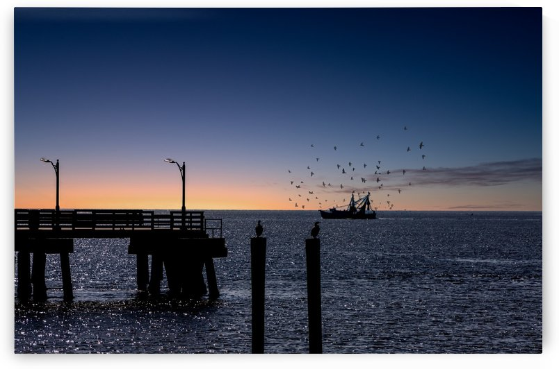 Shrimp boat beyond pier at Dusk by Darryl Brooks