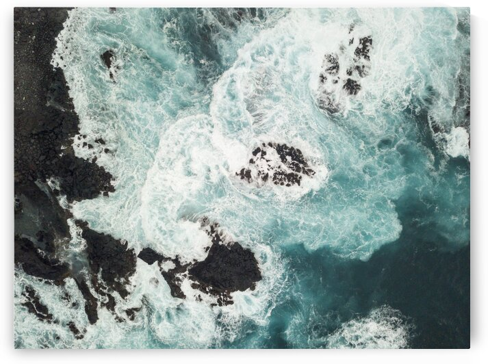 Aerial view of Atlantic ocean waves hitting rocks Sao Miguel island in the Azores Portugal by Moe Shirani