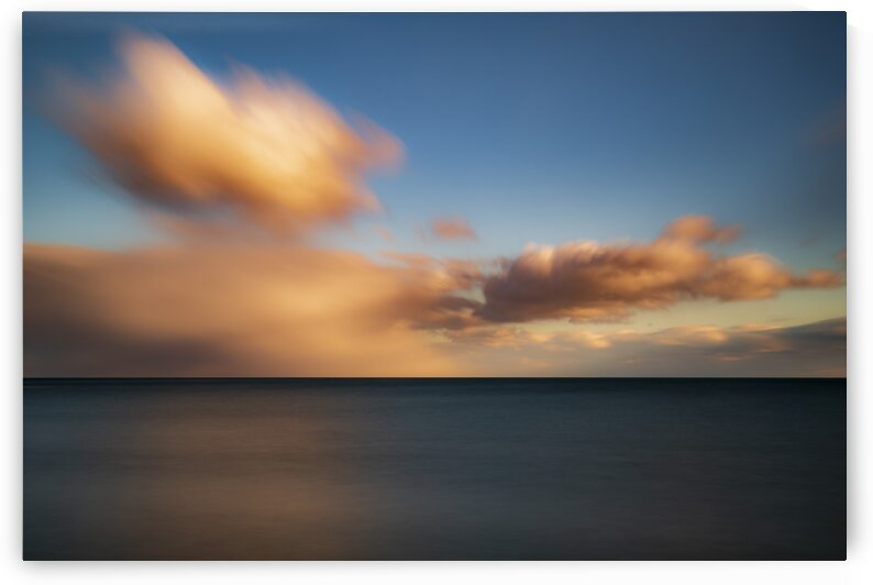 Long exposure picture of a sunset above lake Ontario⁠ by Moe Shirani