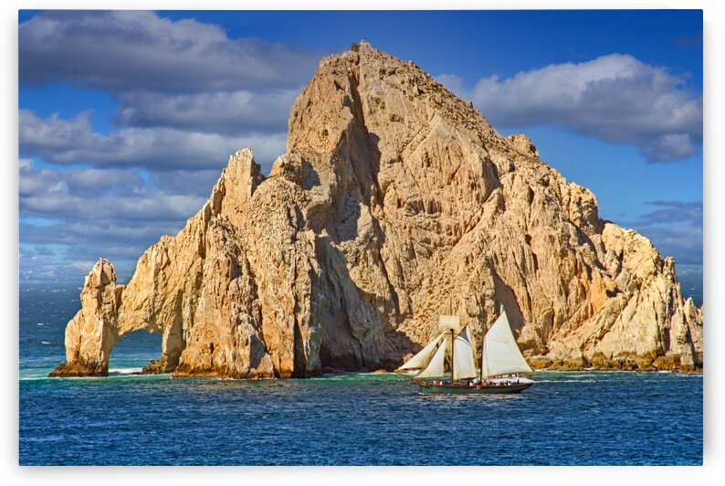SailboatPassingRocksinCaboSanLucas by Darryl Brooks