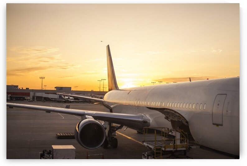 Airplane in airport during sunset Panama city Florida USA by Atelier Knox