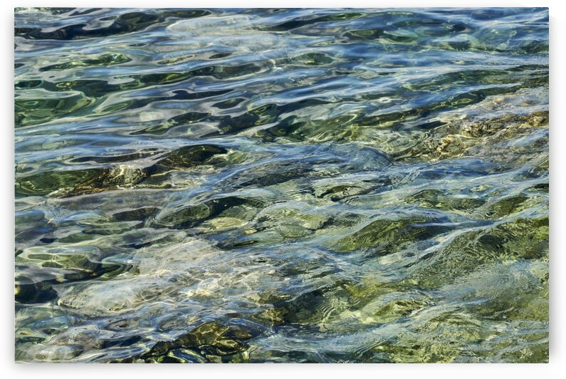 Close up of water on shore of slovenian resort town Piran Slovenia by Atelier Knox