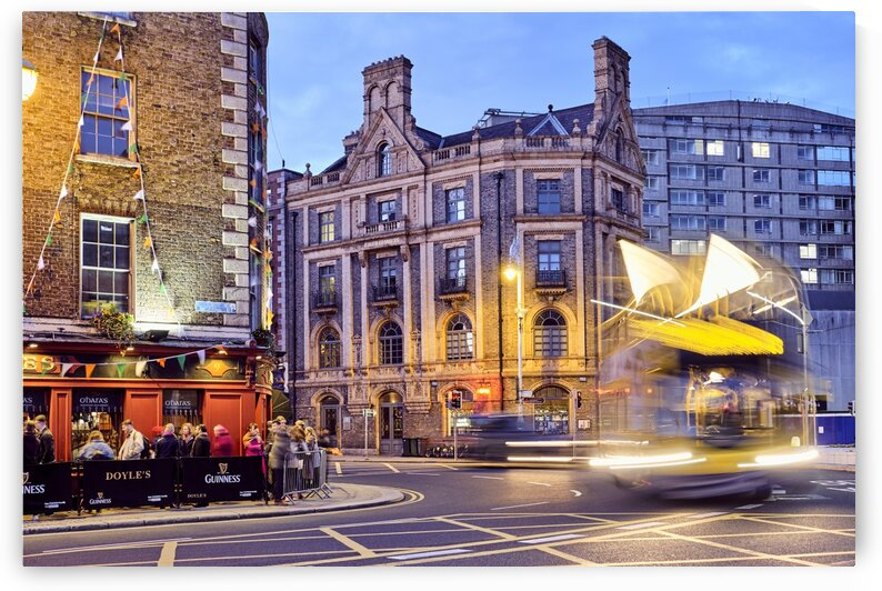 City street with people outside of pub at night Dublin Ireland by Atelier Knox