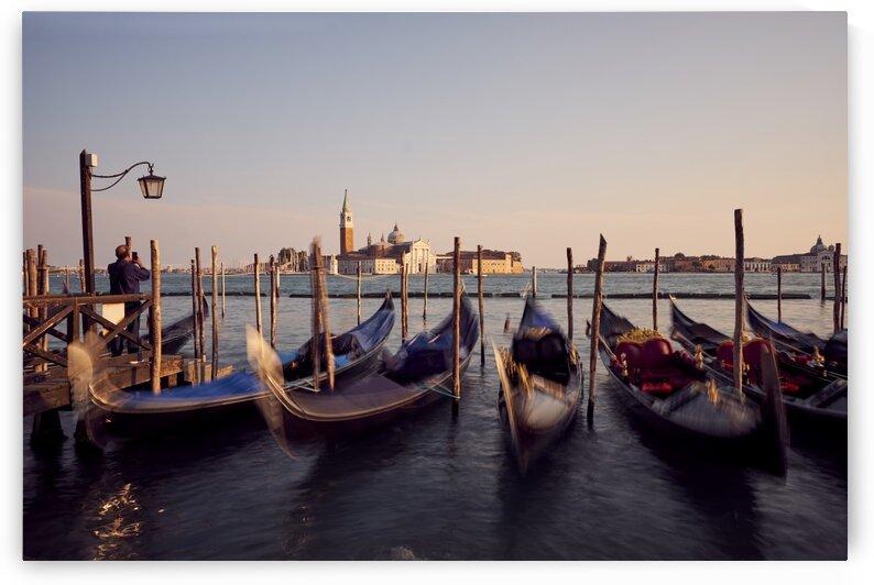 Venetian gondolas in the adriatic sea on the edge of San Marco Venice Italy by Atelier Knox