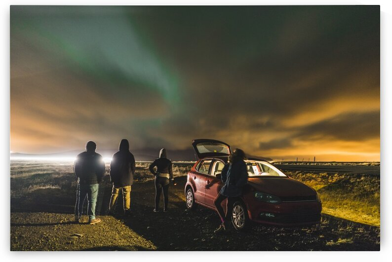 Friends on Northern lights midnight roadtrip while traveling around Iceland Europe by Atelier Knox