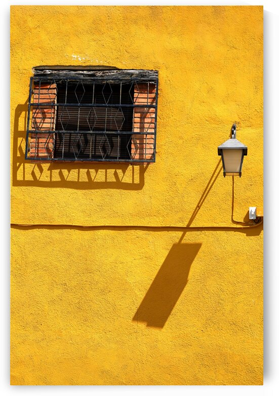 Facade With Vintage Window and Street Lintern With Their Shadows Projecting On An Orange-Yellow Wall by ParaKrytous
