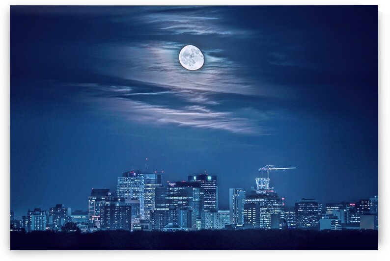 Moonrise Over Downtown Winnipeg Photo by Jonathan Kozub