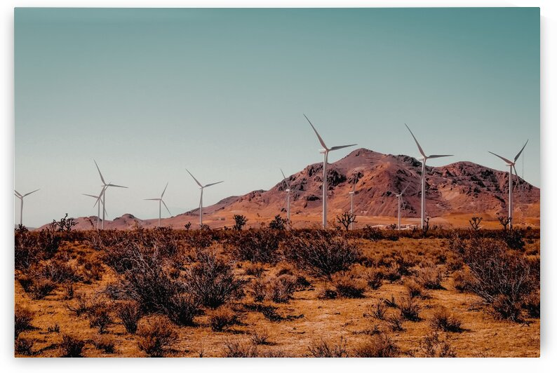 Wind turbine in the desert with mountain view at Kern County California USA by TimmyLA