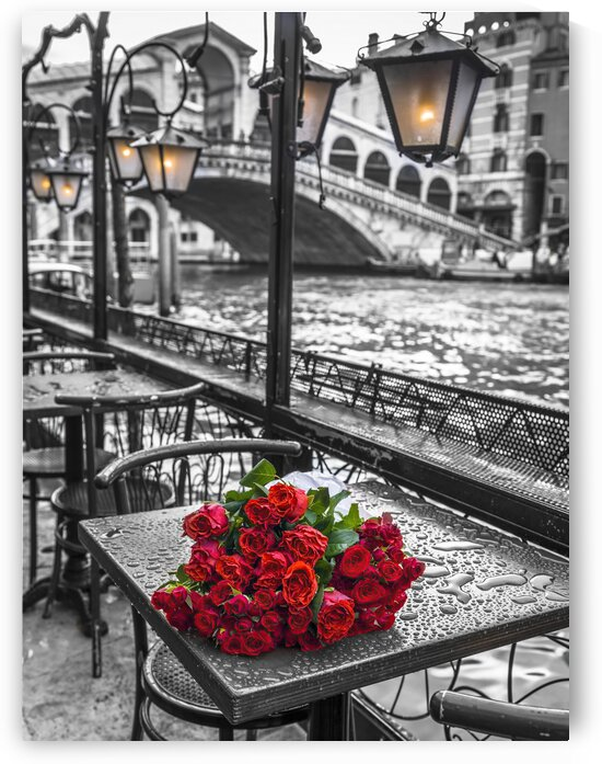 Bunch of red roses on street cafe table, Rialto Bridge, Venice, Italy by Assaf Frank