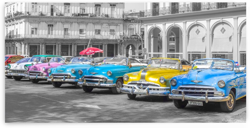 Traditional cuban cars parked in row by the road in Havava, Cuba by Assaf Frank