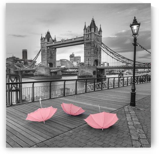 Pink umbrellas at Tower bridge, London, UK by Assaf Frank