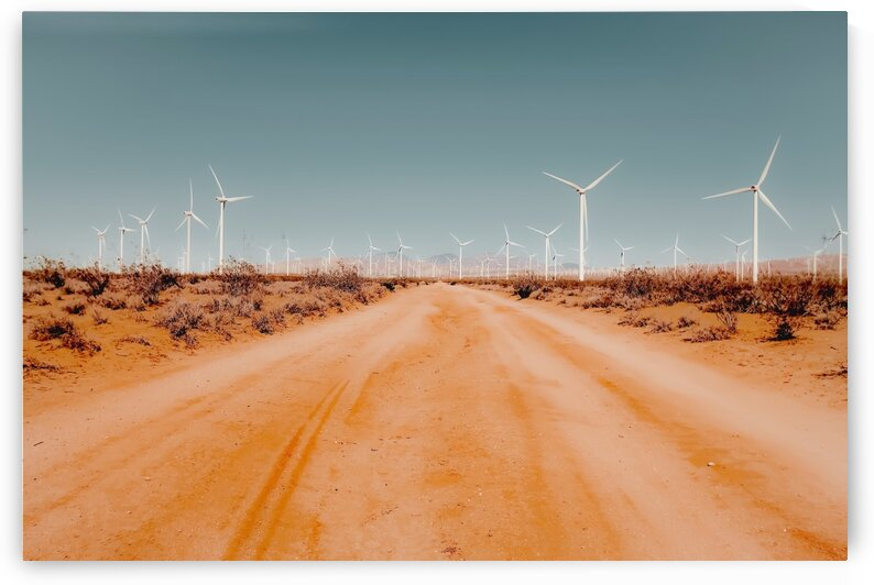 Wind turbine in the desert with sandy road at Kern County California USA by TimmyLA