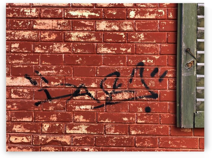 Black Graffiti on a Deep Red Brick Wall with a Deep Green Shutter of an old House by Swiss Art by Patrick Kobler