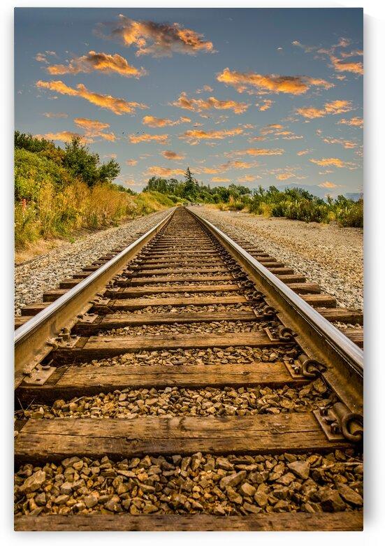 Straight Railroad Tracks at Dusk by Darryl Brooks