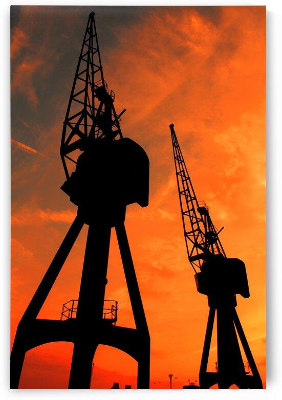 Sunset port tower cranes by Bentivoglio Photography