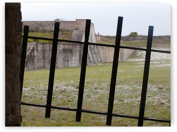 Behind iron gate in Fort Pickens by by Tara