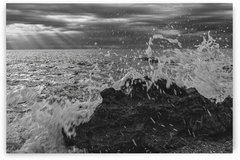 Waves crashing against the rocks in black and white Costa Azahar by Vicen photography