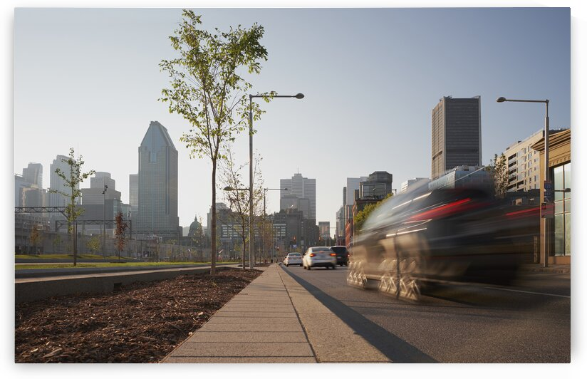 Motion blur of cars driving on street  in downtown urban area Montreal Quebec Canada by Atelier Knox