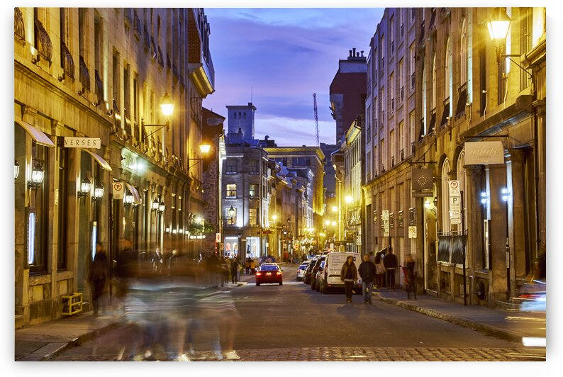 Tourists walking around at night in citys tourist district Montreal Quebec Canada by Atelier Knox
