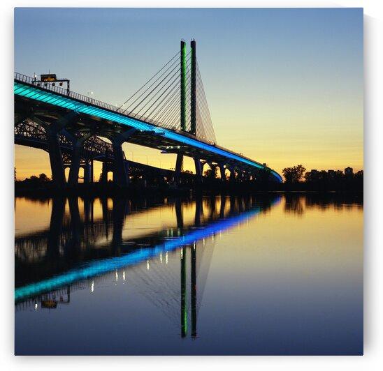 Illuminated Samuel-de Champlain bridge at sunset Brossard Quebec Canada by Atelier Knox
