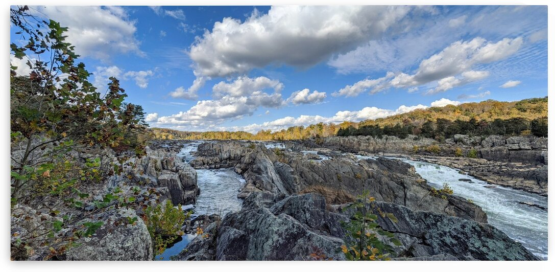 Wide angle view of a stretch of rapids along a river by Michael Geyer