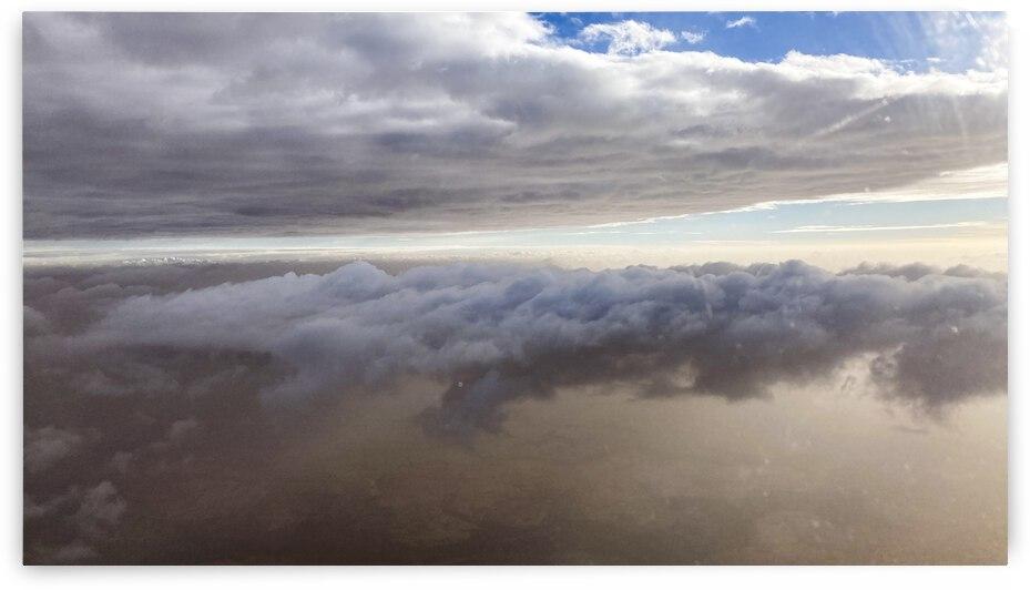 Clouds above the desert  by L Enchanteur