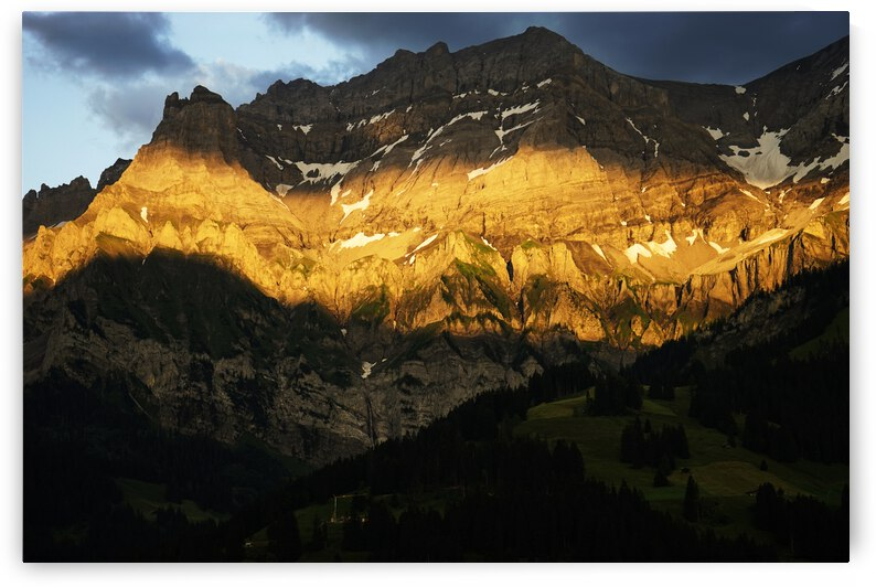 Mountain Bathed in the Golden Rays of the Sun at Sunset in Switzerland 2 of 3 by 1North