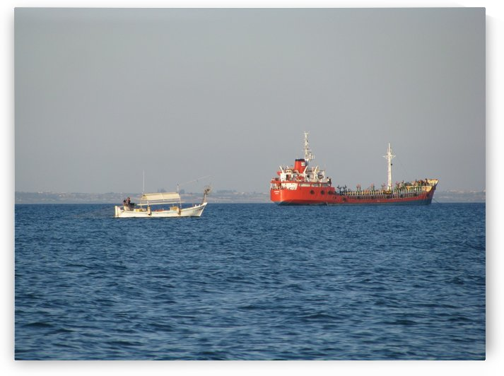 Boats fishing near the Cypriot shore of Larnaca by Vlad Radulian