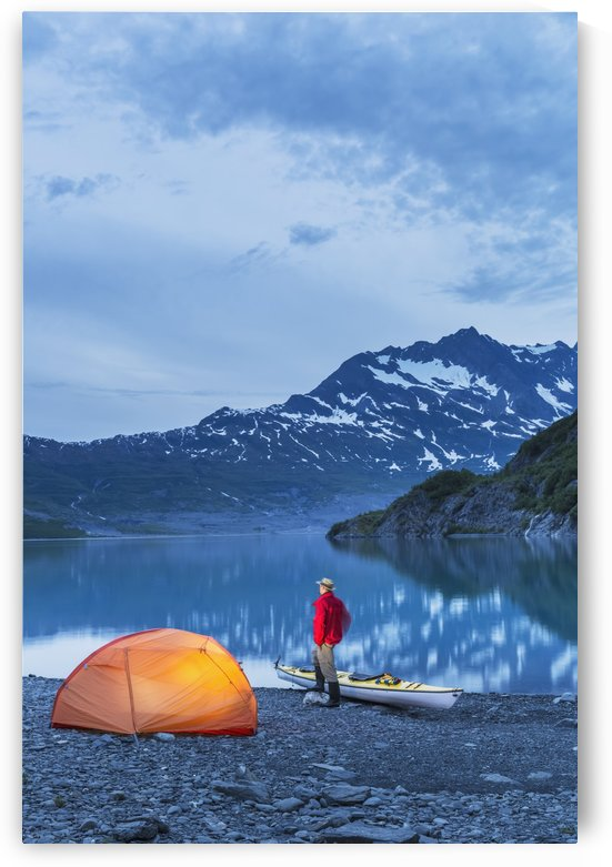 Man camping with a tent and kayak at Shoup Bay State Marine Park, Prince William sound, Valdez, Southcentral Alaska by PacificStock
