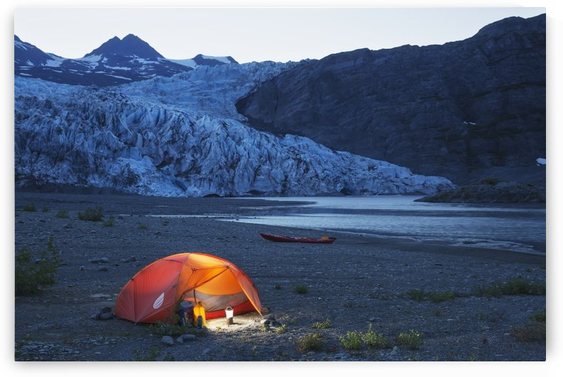 Glowing tent and kayak on the beach in front of Shoup glacier and mountains at dusk, Shoup Bay State Marine Park, Prince William Sound, Valdez, Southcentral Alaska by PacificStock