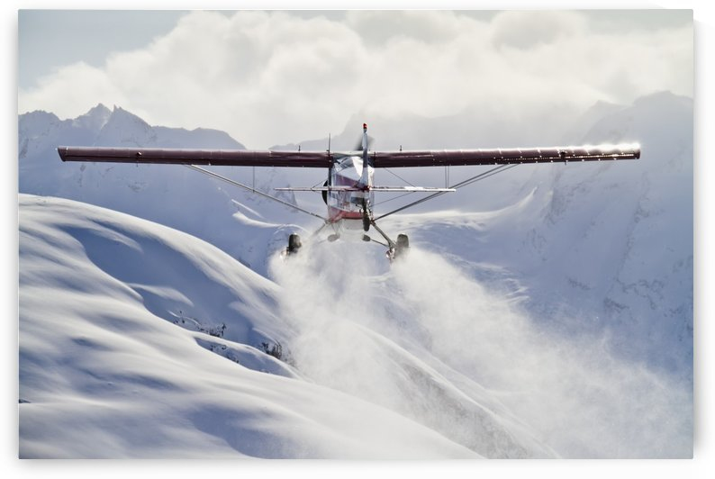 View of a Super Cub air taxi at Tanaina Glacier in the Neacola Mountains, Aleutian Range, Southcentral Alaska, Winter by PacificStock