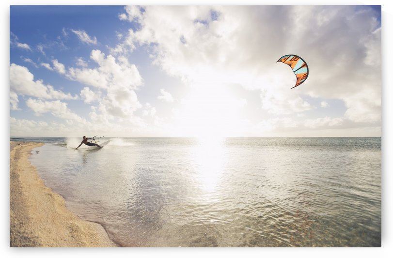 Kiteboarding in tropical lagoon in the South Pacific at sunset; Tikehau, French Polynesia by PacificStock