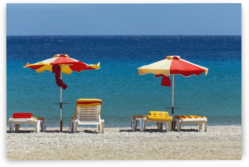 Umbrellas and beach chairs on a beach on the Island of Kos; Kefalos, Greece by PacificStock