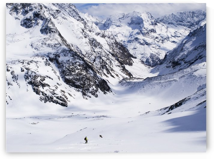 Two distant skiers descend from Chateau de dames into Cervinia; Italy by PacificStock