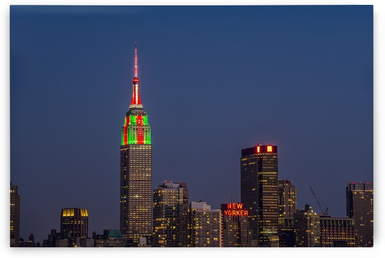 Empire State Building at twilight in colours celebrating Christmas; New York City, New York, United States of America by PacificStock