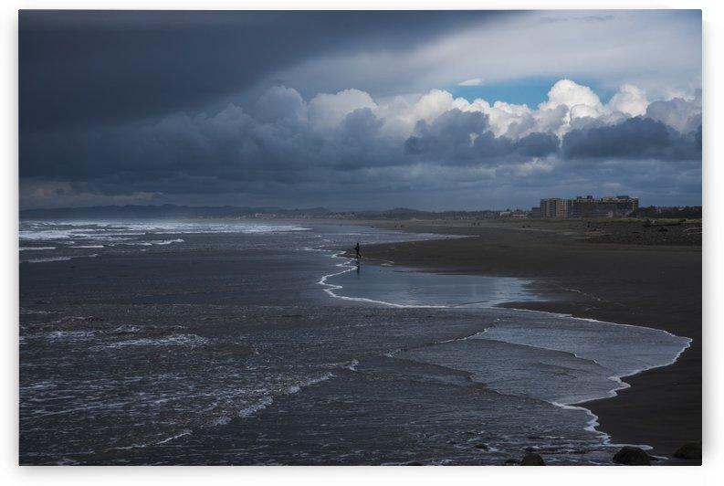 Storm clouds loom over the beach; Seaside, Oregon, United States of America by PacificStock