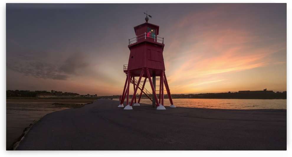Herd Groyne Lighthouse on the water's edge of the River Tyne at sunset; South Shields, Tyne and Wear, England by PacificStock