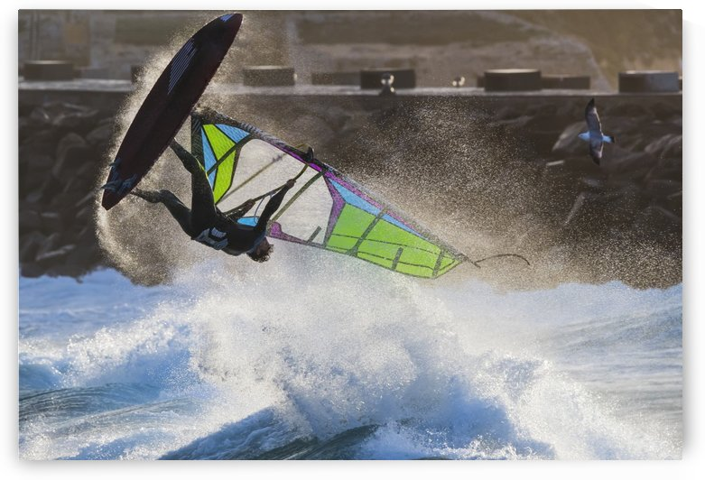 Windsurfer flipping upside down over the water; Tarifa, Cadiz, Andalusia, Spain by PacificStock