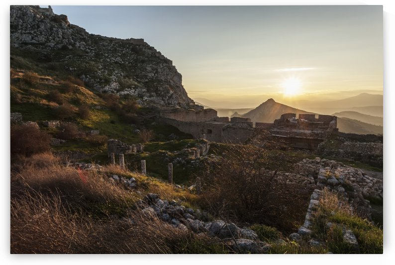 Ruins of stone buildings and walls at sunset; Corinth, Greece by PacificStock