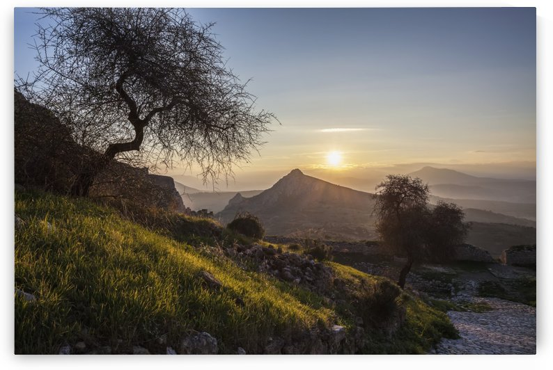 Sun setting over the peaks of mountains; Corinth, Greece by PacificStock
