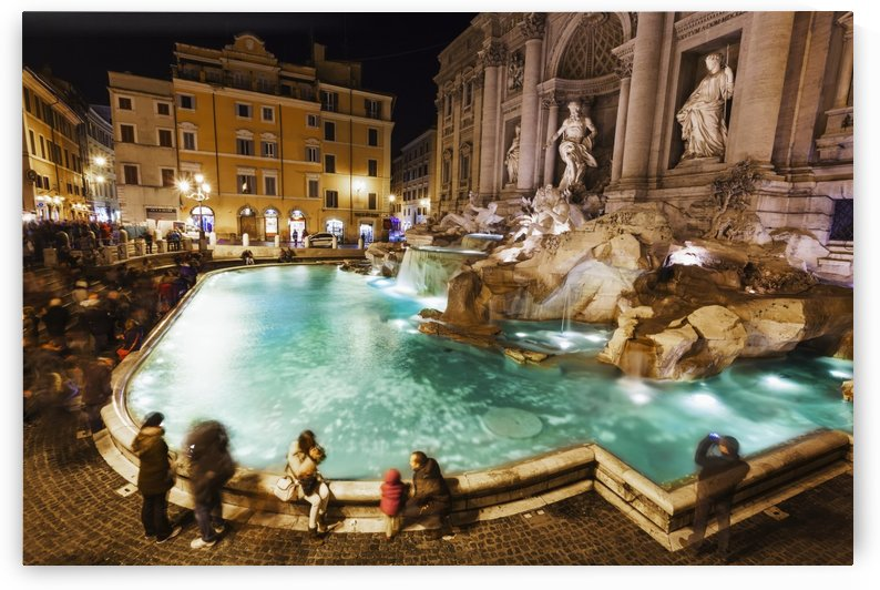 Tourists at Trevi Fountain at nighttime; Rome, Italy by PacificStock