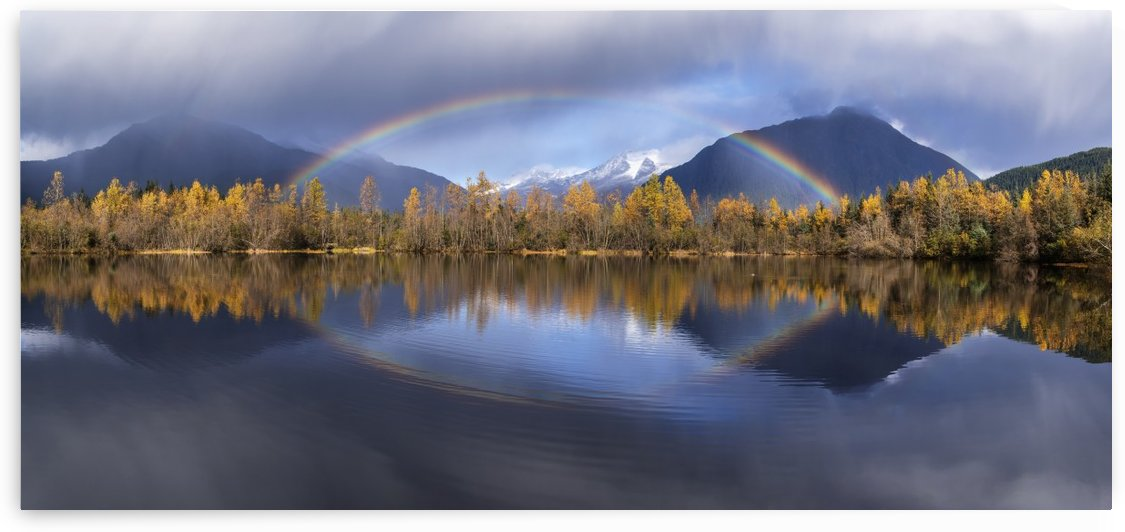 Scenic view of autumn rain showers and a rainbow reflected in Moose Lake, Mendenhall Recreation Area, Tongass National Forest, Juneau, Southeast Alaska by PacificStock
