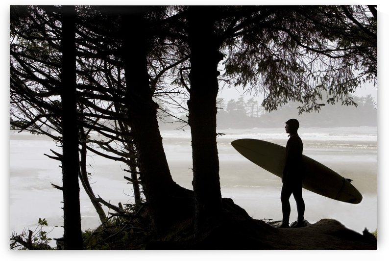 Silhouette Of A Surfer Looking Out To The Water by PacificStock